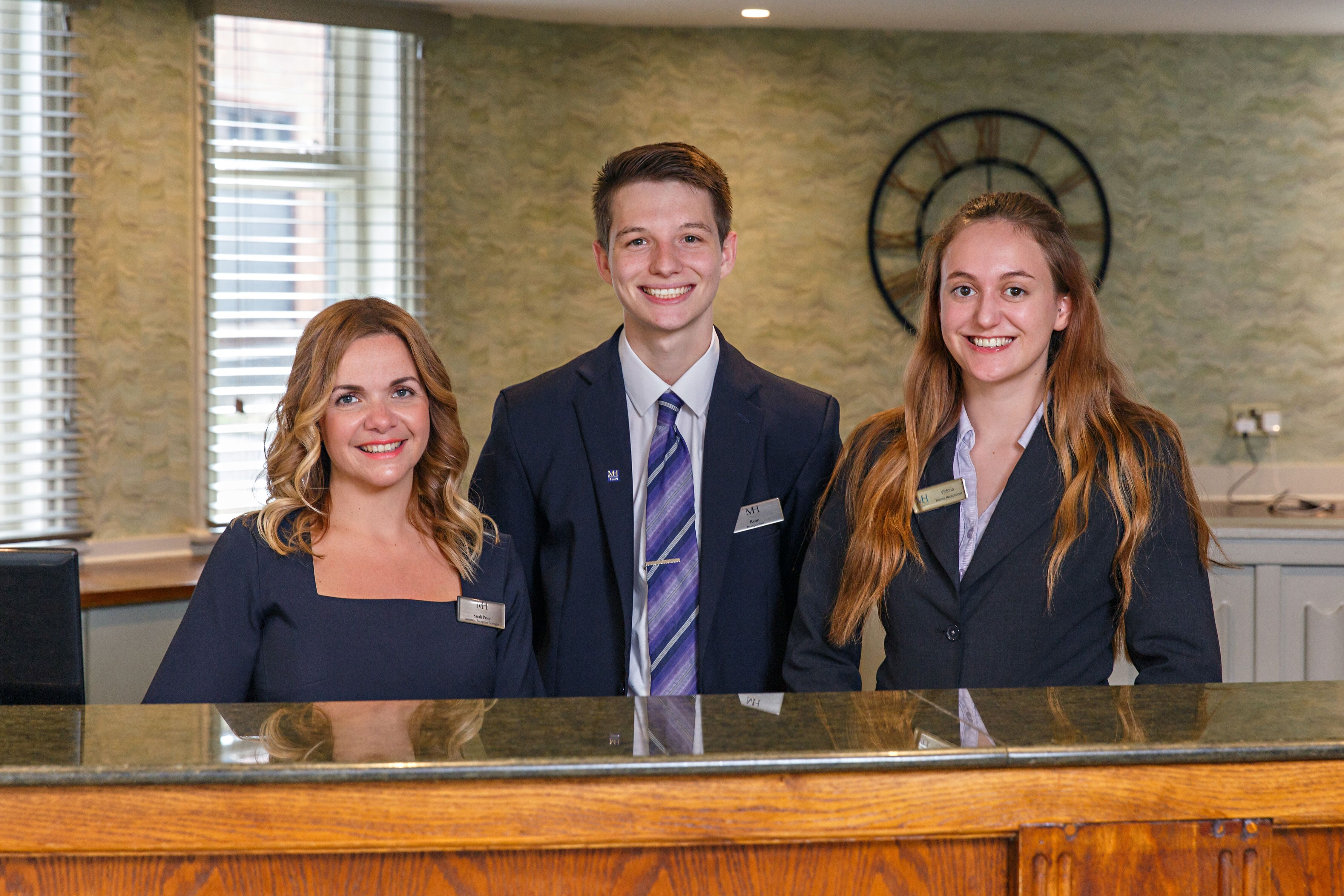 Ryan Fox, centre, with (L) Sarah Prior, Assistant Reception Manager and (R) Victoria, Trainee Receptionist, The Maids Head Hotel