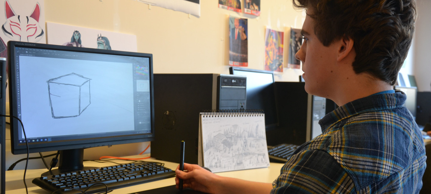City College student Alex sketching on computer