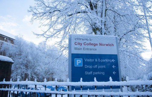 City College exterior main entrance sign in the snow