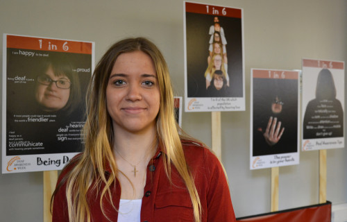 CCN-student-Karolina-Michalik-with-her-deaf-awareness-campaign-posters-Credit-City-College-Norwich