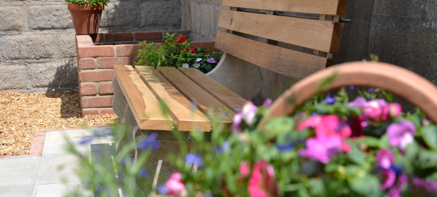 Flowers and bench at East Harling Youth Centre memorial garden
