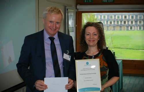 Lisa James, Head of Adult Education, collecting Gareth's Palmer's CAVA Keith Fletcher Regional Runner Up Award for Outstanding Commitment to Study