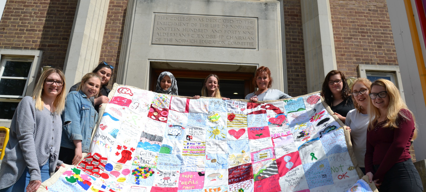 Group-pic-with-quilt-cropped