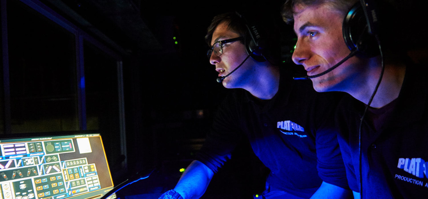 Two male students working on technical desk at Platform Theatre