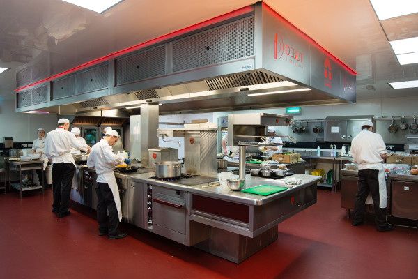 City College catering students cooking in industrial kitchen