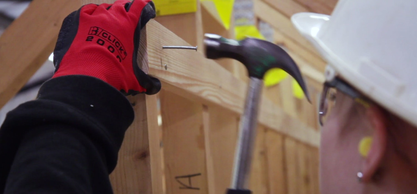 City College Carpentry and Joinery student hammering a nail into timber
