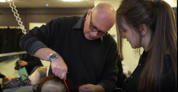 Hairdressing student, Annabel Baxter, with tutor working on hair