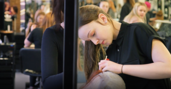 Hairdressing student, Annabel Baxter, working on hair