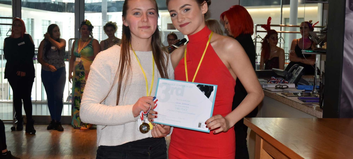 Two City College hairdressing students celebrating with certificate and medals at Suffolk New College inter-college competition